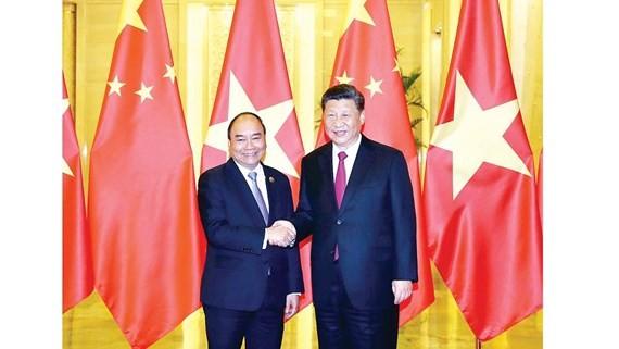 Thủ tướng Nguyễn Xuân Phúc hội kiến Tổng Bí thư Ban Chấp hành Trung ương Đảng Cộng sản Trung Quốc, Chủ tịch nước Cộng hòa Nhân dân Trung Hoa Tập Cận Bình Ảnh: TTXVN