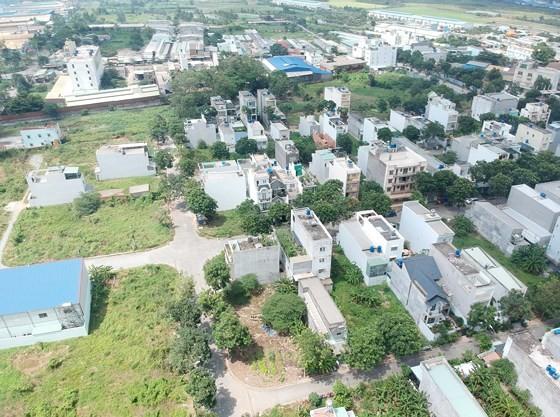 Một góc Khu Dân cư - Trung tâm thương mại xã Tân Nhựt. Ảnh: CAO THĂNG