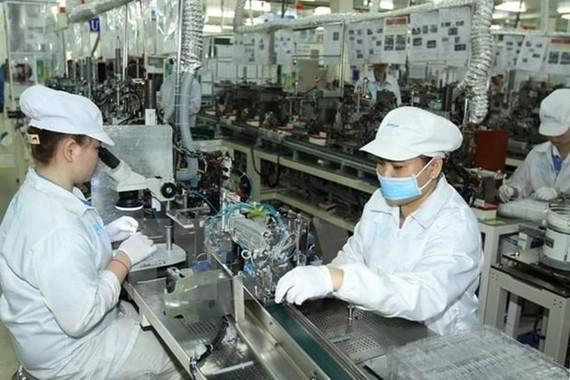 Sản xuất linh kiện điện tử kỹ thuật cao. (Ảnh minh họa. Nguồn: TTXVN)
