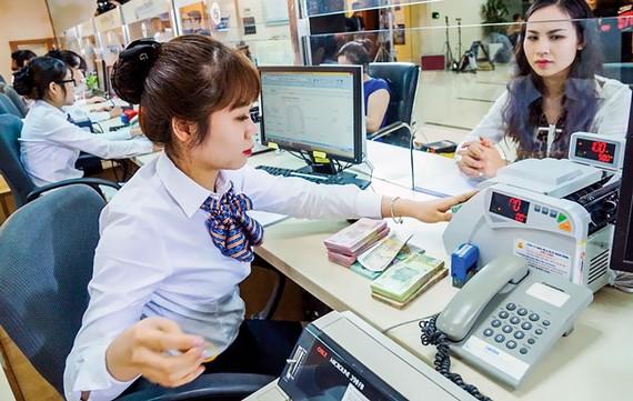 Thói quen sử dụng tiền mặt của người Việt Nam khiến NH số khó phát triển. Ảnh: VIẾT CHUNG