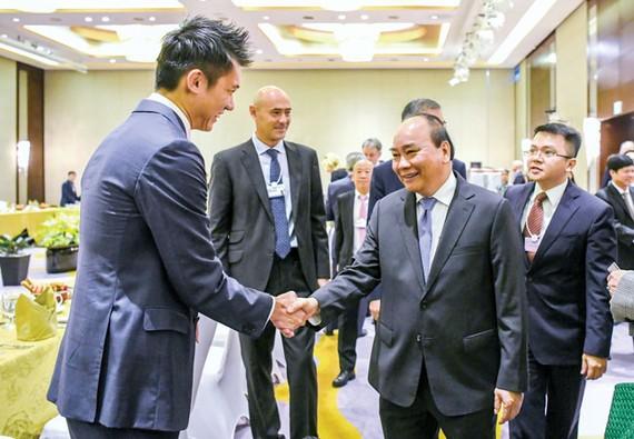 Thủ tướng Nguyễn Xuân Phúc chào mừng các doanh nghiệp tại VBS 2018. Ảnh: VIẾT CHUNG