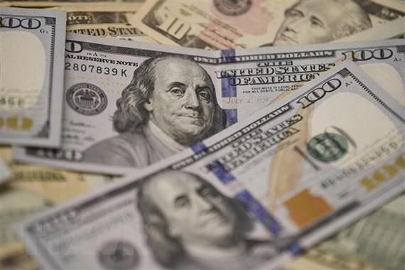 Đồng USD tại một ngân hàng ở Washington, DC, Mỹ. (Nguồn: THX/TTXVN)