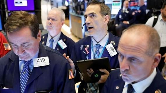 Hoạt động giao dịch tại sàn chứng khoán New York. (Nguồn: Reuters)