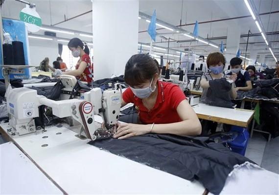Công nhân dệt may. (Ảnh minh họa. Nguồn: TTXVN)