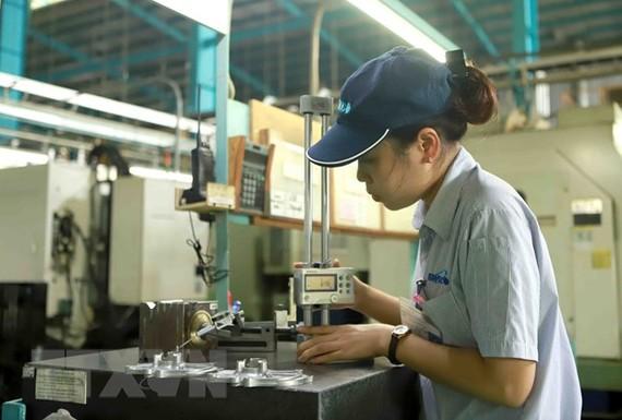 Hoạt động sản xuất tại Công ty trách nhiệm hữu hạn Strong Way khu công nghiệp Khai Quang, tỉnh Vĩnh Phúc. Ảnh minh họa. (Ảnh: Hoàng Hùng/TTXVN)
