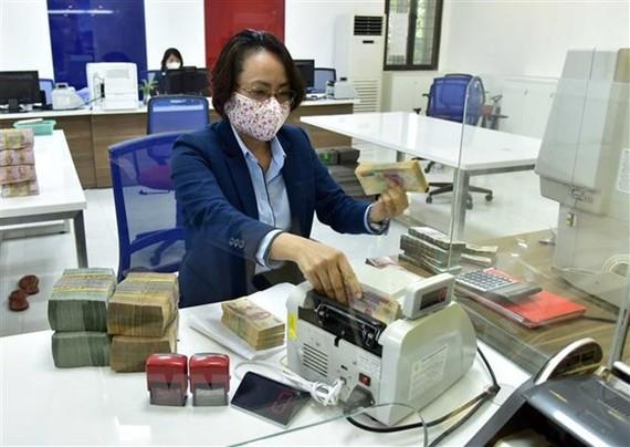 Hoạt động nghiệp vụ tại VietinBank. (Ảnh minh họa: Trần Việt/TTXVN)