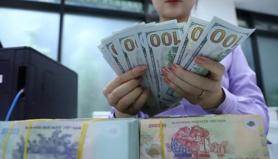 Việt Nam không phá giá VNĐ
