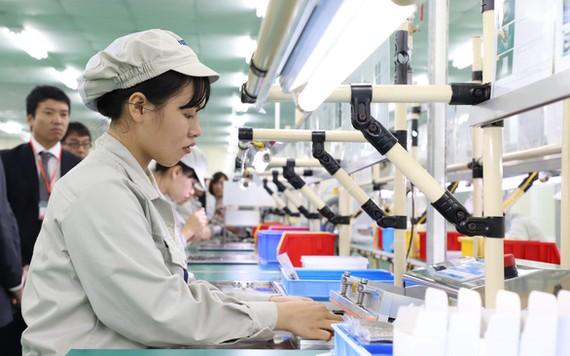 Nhiều doanh nghiệp kỳ vọng môi trường kinh doanh ở Hà Nội và TP.HCM sẽ thăng hạng để thúc đẩy sự phát triển mạnh hơn - Ảnh: Đ.TUÂN