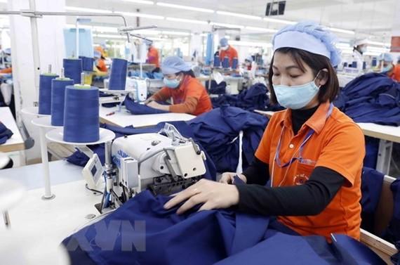 Sản xuất hàng dệt may. (Nguồn: TTXVN)