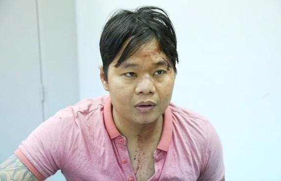 Đối tượng Nguyễn Thanh Hùng tại cơ quan công an