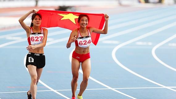 TPHCM đang kêu gọi đầu tư sân vận động 50.000 chỗ có đường chạy điền kinh theo tiêu chuẩn quốc tế tại quận 2. Trong ảnh: Chiến thắng của điền kinh Việt Nam tại SEA Games 29. Ảnh: DŨNG PHƯƠNG