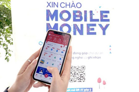Viettel has successfully launched its pilot scheme for Mobile Money. (Photo: SGGP)