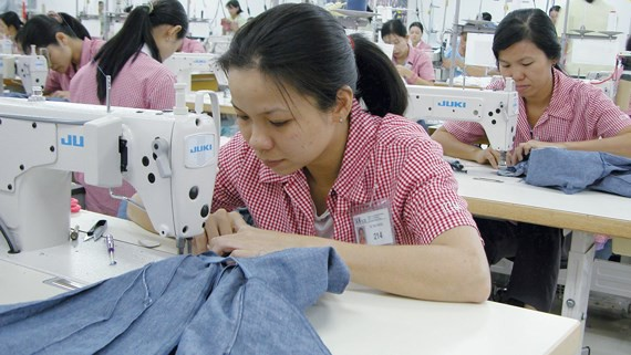 Workers at Japanese company, IGM, in District 7 in Ho Chi Minh City. (Photo: SGGP)