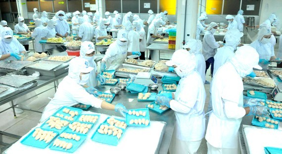 Food processing at the factory of CJ Group invested in Ho Chi Minh City. (Photo: SGGP)
