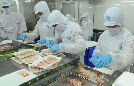 Food processing at SG Food Company. (Photo: SGGP)