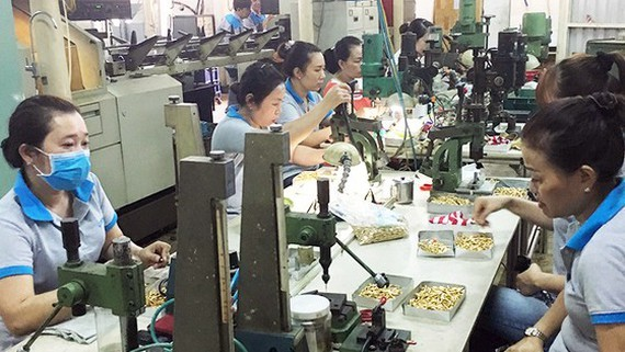 Components manufacturing for export at a mechanical enterprise in Ho Chi Minh City. (Photo: SGGP)