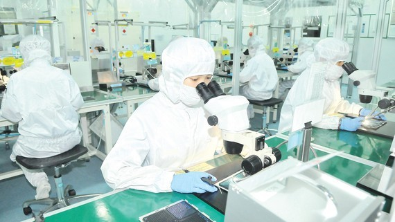 Electronic component production at MTEX Company (Japan) in HCMC. (Photo: SGGP)