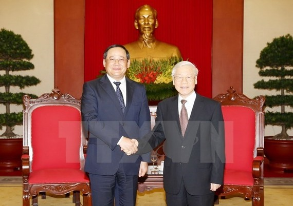 General Secretary of the Communist Party of Vietnam (CPV) Nguyen Phu Trong (R) and Lao Deputy Prime Minister Sonexay Siphandone (Source: VNA)