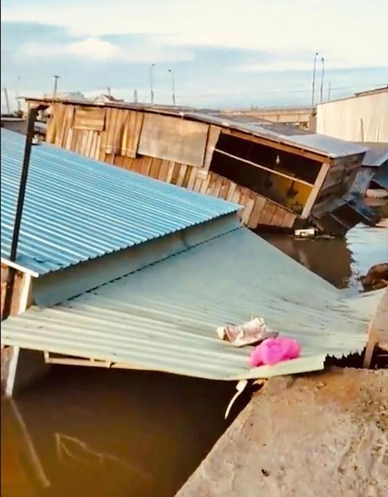 Houses collapse after landslide.