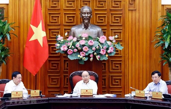 Prime Minister Nguyen Xuan Phuc speaks at the meeting. (Photo: VNA)