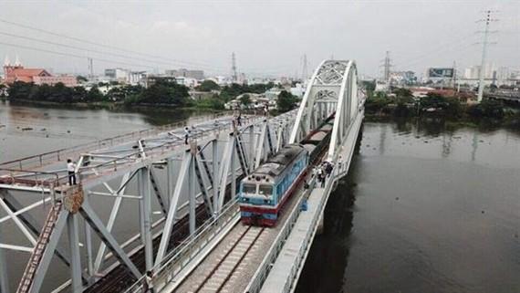 The new Binh Loi Bridge crossing Sai Gon River in HCM City opens to train traffic on September 14. (Photo: VNA/VNS)