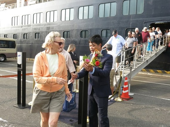 At welcoming ceremony greeting first international cruise visitors on the lunar New Year