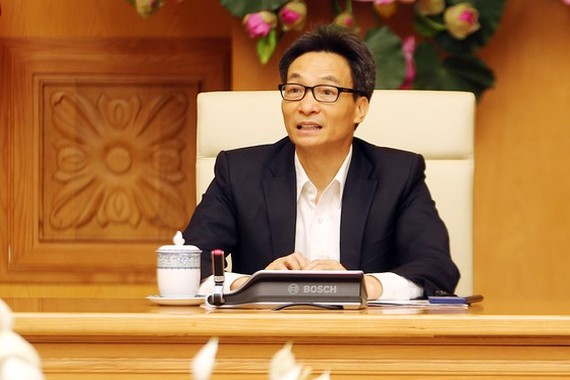 Deputy Prime Minister Vu Duc Dam, head of the National Steering Committee for Prevention and Control of the Acute Respiratory Disease Caused by a New Coronavirus (nCoV) in the meeting