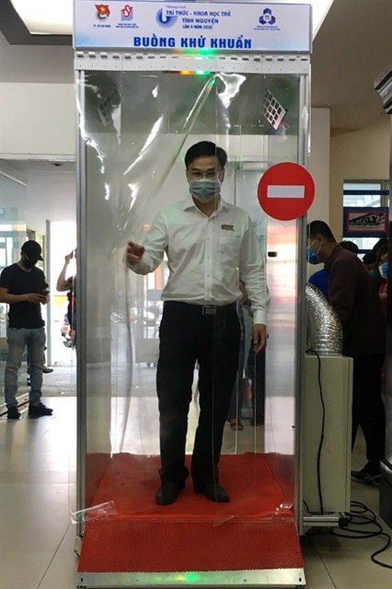 A man tries to use a mobile disinfection chamber at a launching ceremony held in HCM City on March 18. (Photo: VNA)