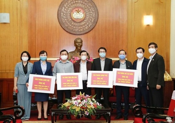 The VFF central Committee receives funds from the Party Central Committee Office,  the Government Office, the National Assembly Office, and the President Office (Photo: dangcongsan.vn)