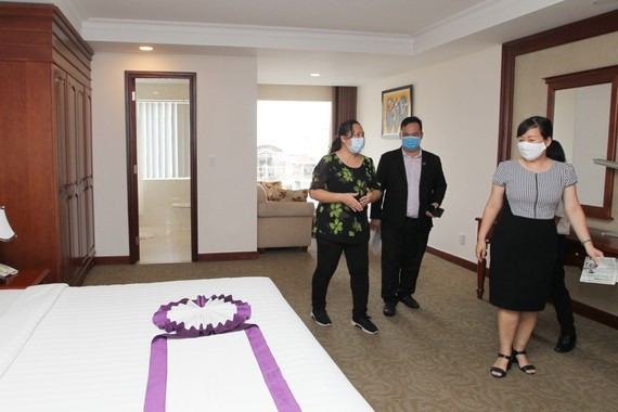An inspection team of the municipal Department of Health makes a survey of a TTC's hotel.