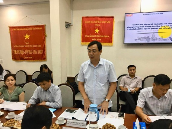 Chairman of Vietnam National Administration of Tourism Nguyen Trung Khanh speaks at the meeting. (Photo: SGGP)