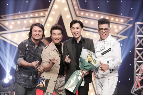 Director Hoang Nhat Nam (L), singers Dam Vinh Hung (2nd, L) and Duong Trieu Vu, MC Thanh Bach (R) join the event.