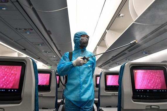 A worker cleaning and disinfecting an aircraft