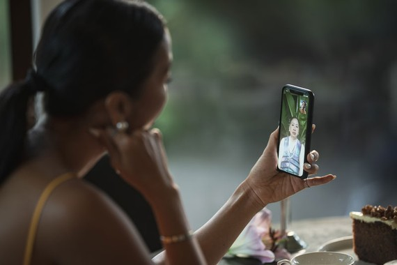 Model, actress Bang Lang makes a phone call with her mother in Vietnam during the COVID pandemic.