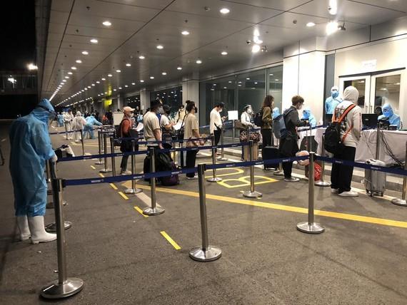 Passengers get health checks at Van Don International Airport.