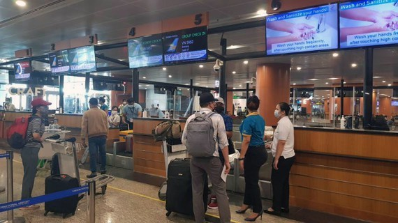 Passengers complete check-in procedures at Yangon Airport.