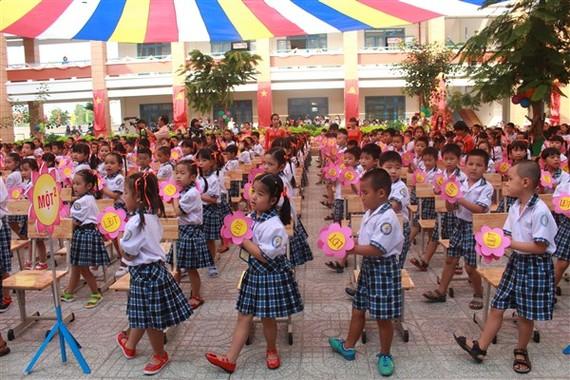 Học sinh Trường Tiểu học Lê Đức Thọ (quận Gò Vấp) trong ngày khai giảng năm học mới