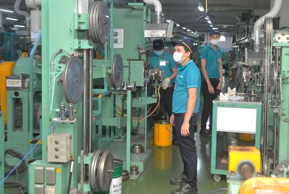 Sản xuất dây cáp điện xuất khẩu tại Công ty Nissei Electric trong KCX Linh Trung 1, TP Thủ Đức. Ảnh: CAO THĂNG