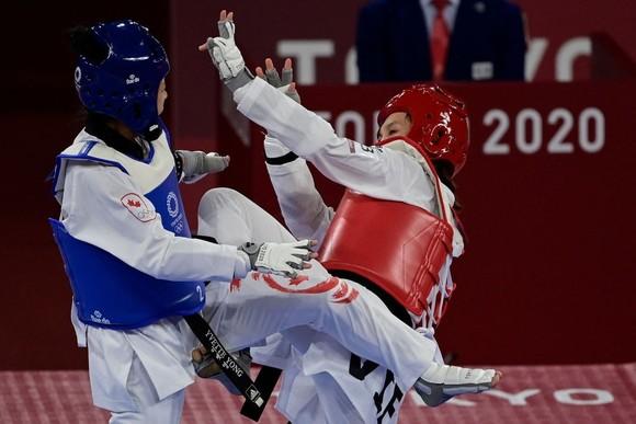 Nguyễn Văn Đương đánh bại võ sĩ Azerbaijan, Trương Thị Kim Tuyền dừng bước ảnh 1