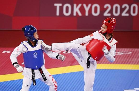 Võ sĩ Trương Thị Kim Tuyền thi đấu tại Olympic. Ảnh: REUTERS