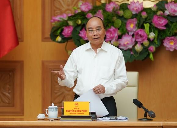 Thủ tướng Nguyễn Xuân Phúc chủ trì họp ngày 9-7, ảnh QUANG PHÚC