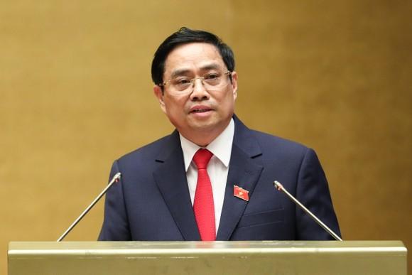 Thủ tướng Chính phủ Phạm Minh Chính trình bày Tờ trình về cơ cấu số lượng thành viên Chính phủ khóa XV. Ảnh: QUANG PHÚC