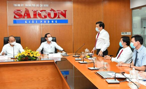 Chủ tịch nước Nguyễn Xuân Phúc: Báo SGGP đổi mới tư duy, quyết liệt hành động để xứng đáng vị thế của TPHCM ảnh 7
