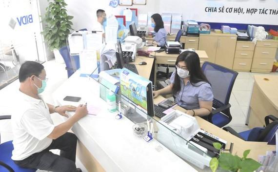 Nhu cầu tuyển dụng nhân sự cấp cao ở ngành ngân hàng, công nghệ thông tin vẫn cao ảnh 1