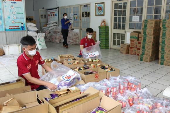 14.000 tấn gạo hỗ trợ của Chính phủ được TPHCM phát tới người dân trước ngày 5-9 ảnh 4