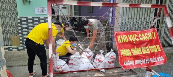 14.000 tấn gạo hỗ trợ của Chính phủ được TPHCM phát tới người dân trước ngày 5-9 ảnh 3