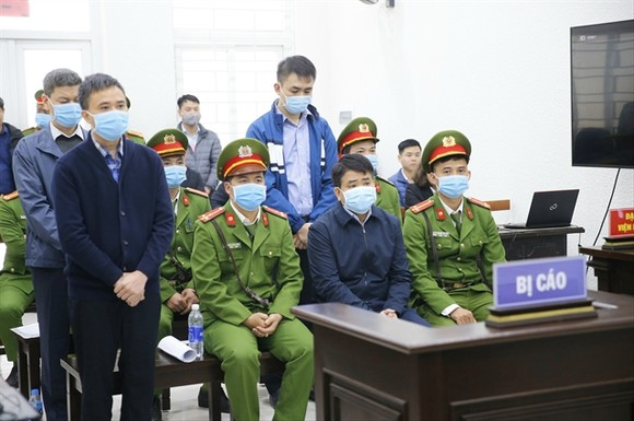 Nguyen Duc Chung, former Chairman of the municipal People's Committee listened to the judges' verdict at Hanoi People's Court in a closed trial on Friday. — VNA/VNS Photo