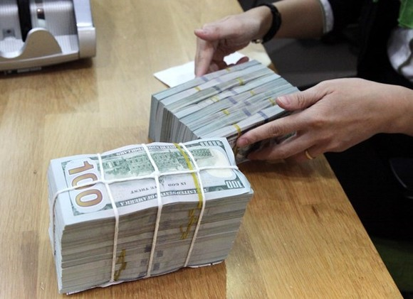 The State Bank of Vietnam set the daily reference exchange rate at VND 23,125 per US$ on February 22. (Photo: VNA)