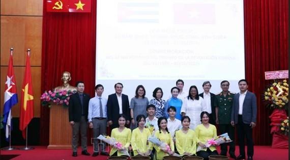 Delegates pose for a picture at the celebration.(Photo: VNA)