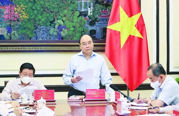 Chủ tịch nước Nguyễn Xuân Phúc, Trưởng Ban Chỉ đạo Cải cách Tư pháp Trung ương, phát biểu. Ảnh: TTXVN